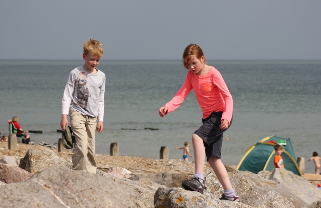 Playing on the Rocks below the Waterwise Garden